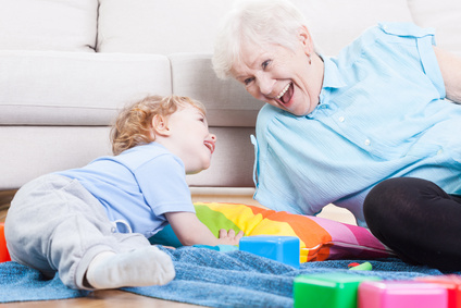 Grandmother playing with grandson